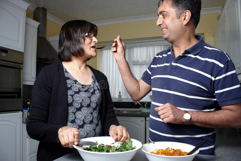 An Asian couple in the kitchen royalty free stock photo
