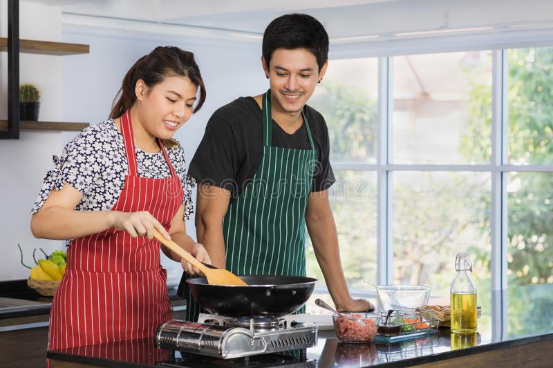 Asian couple at kitchen room stock photography