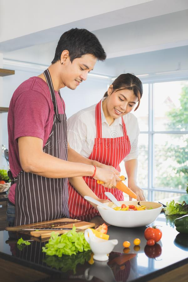 Asian couple at kitchen room stock image