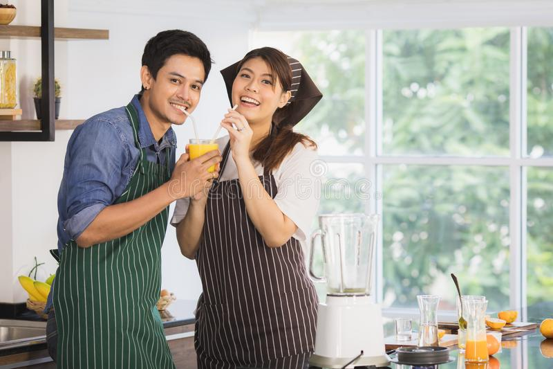 Asian couple at kitchen room royalty free stock images