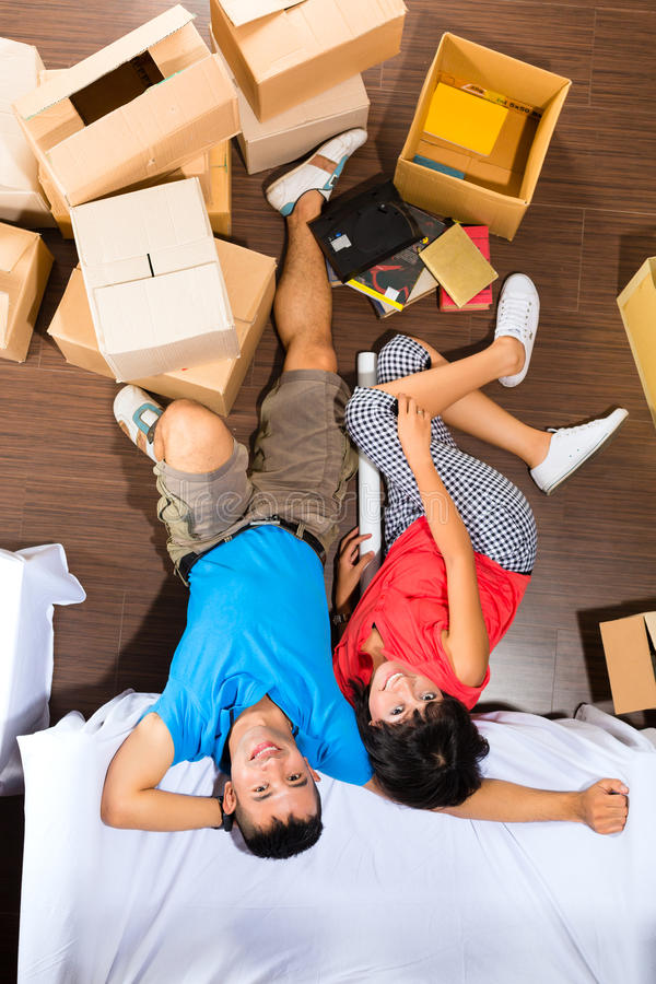 Asian couple moving in the new home stock images