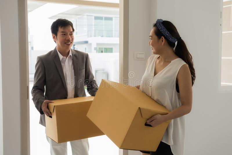 Asian couple moving to new house stock images