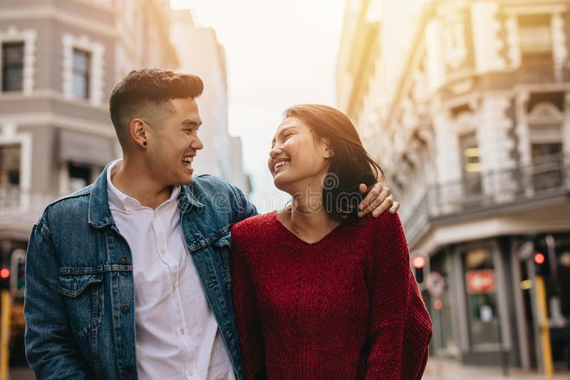 Asian couple outdoors in the city stock photo