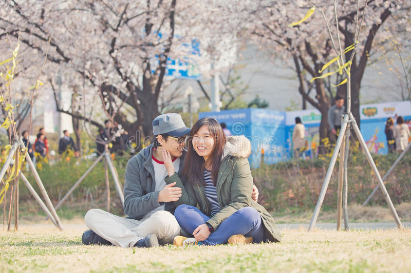 Asian couple in park. It is an asian couple stock photos