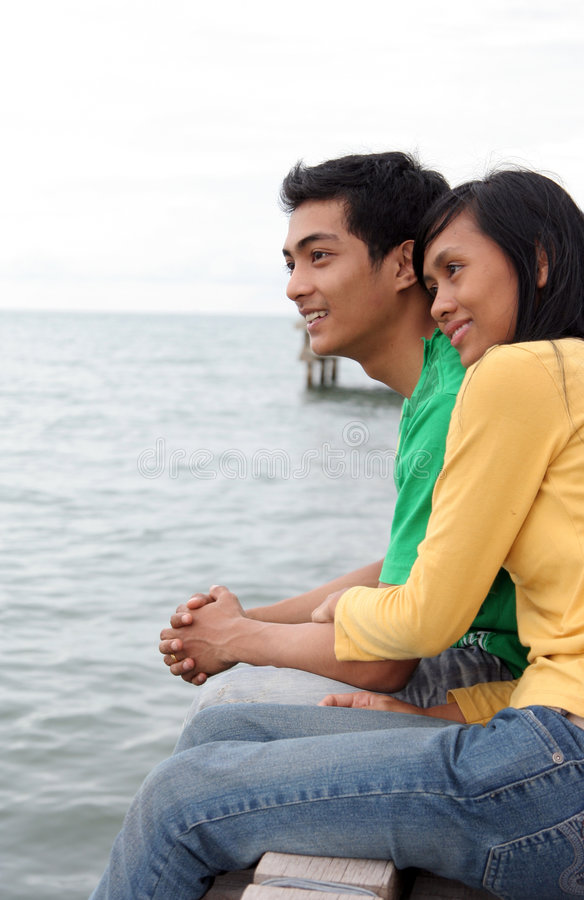 Asian couple on pier. Young adult asian couple on pier stock image