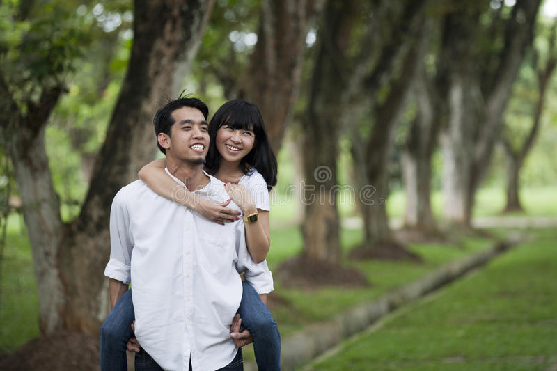 Download Asian couple piggy back stock image. Image of cute, grass - 22809457