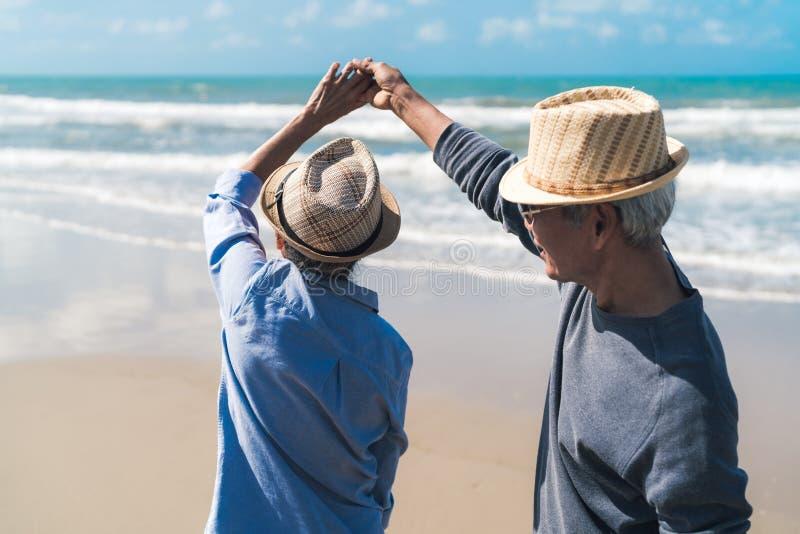 Asian couple senior elder retire resting relax dancing at sunset beach honeymoon royalty free stock photo