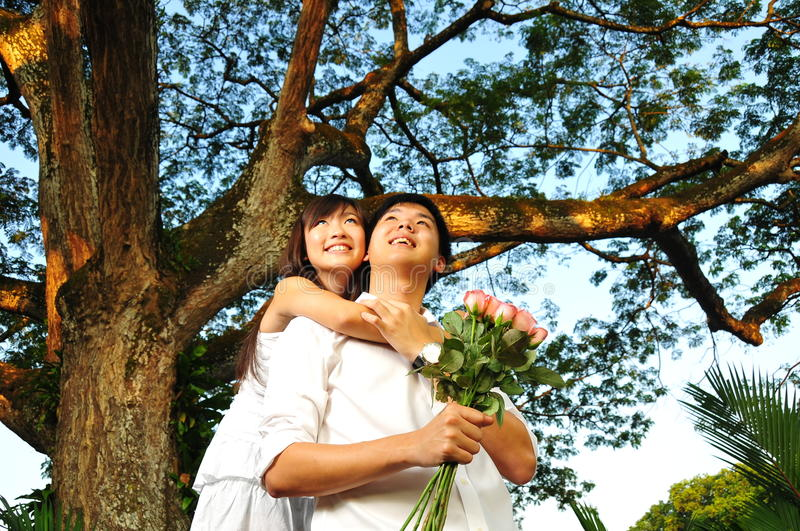 Asian Couple Spending Time In The Park Stock Photos