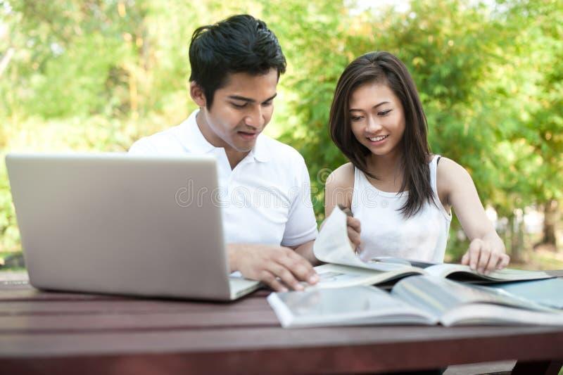 Asian Couple Students Studying stock photo