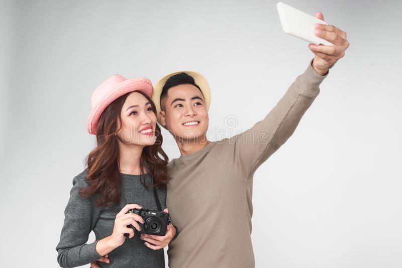 Asian couple take a picture together, smiling and having fun royalty free stock photos