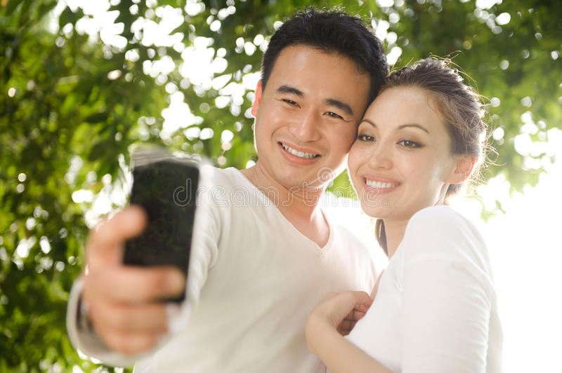 Asian Couple Taking Photographs stock images
