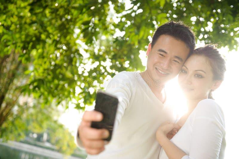 Asian Couple Taking Photographs stock image