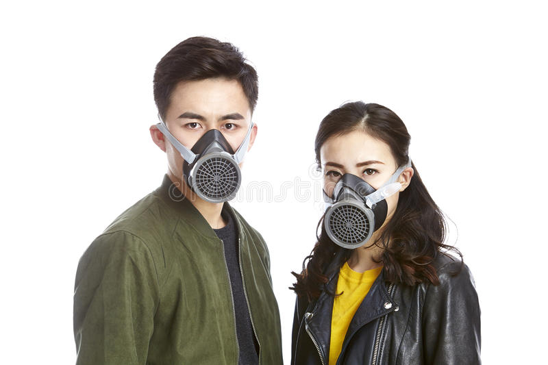 Asian couple wearing gas mask royalty free stock images