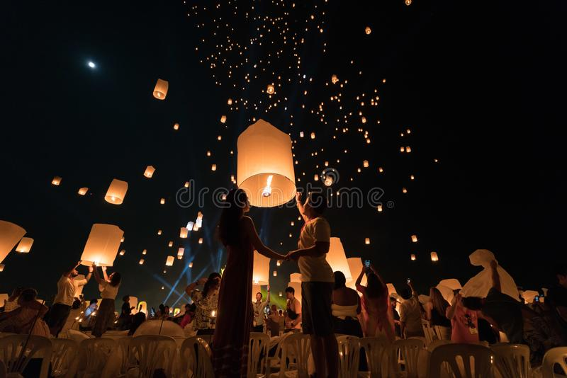 An Asian couple who is going to release a lantern during Chiang Mai lantern festival.  royalty free stock photography