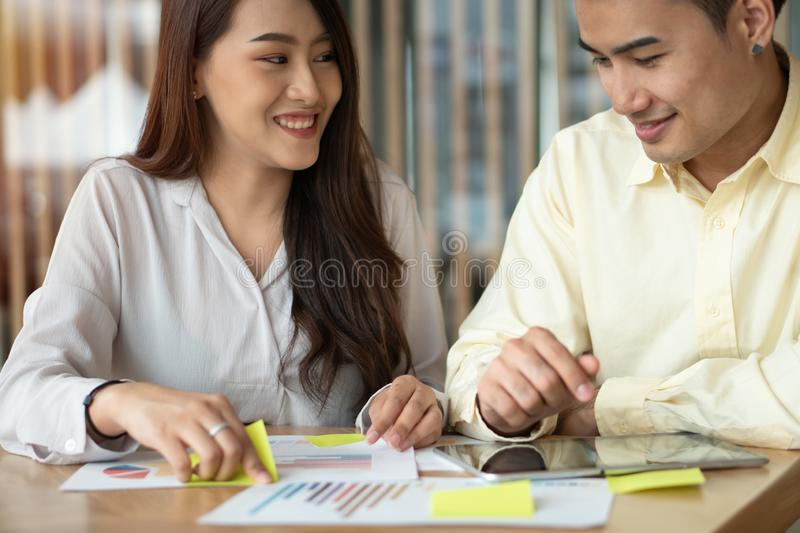 Asian couples are calculating income And expenses To cut unnecessary expenses And planning to borrow money to buy a new home. Conc royalty free stock photography