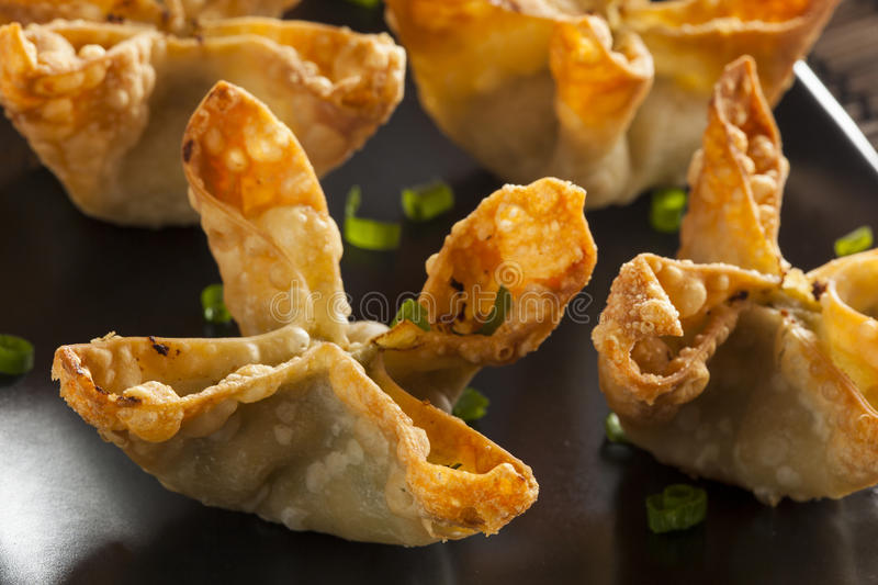 Asian Crab Rangoons with Sweet and Sour Sauce stock images