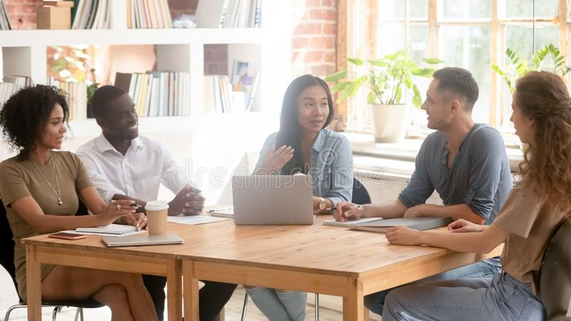 Asian creative leader speaking at diverse team office meeting royalty free stock images
