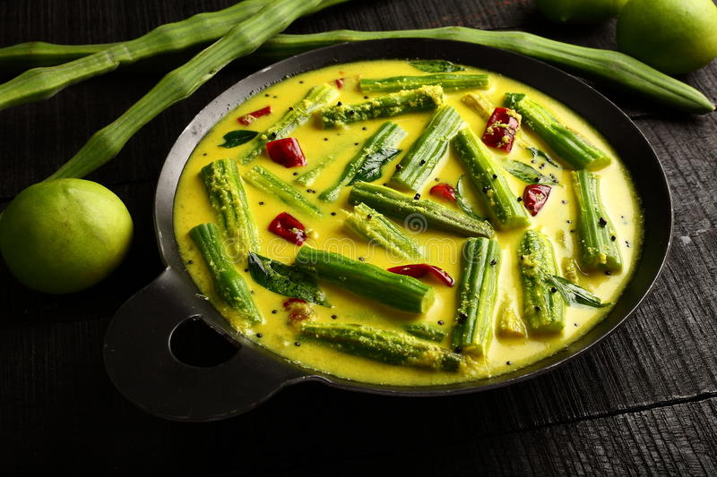 Asian cuisine- moringa mango curry ,. Asian cuisine- moringa mango curry - Drumsticks and Raw Mango in Coconut milk with spices royalty free stock image