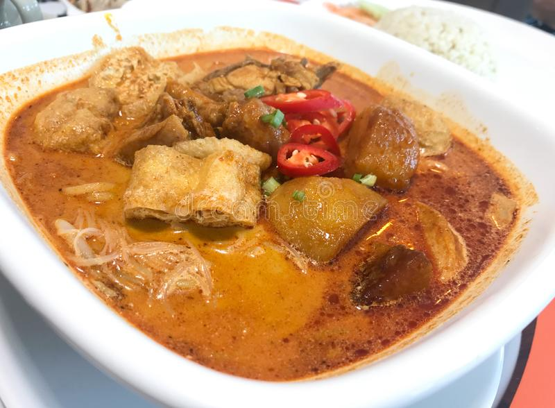Asian Curry Spicy Noodle Soup. Asian food Curry Laksa. Noodle spicy soup with coconut milk, bean curd skin, fish cake, potatoes royalty free stock photography
