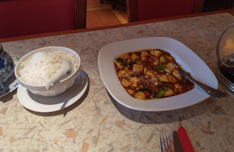 Asian curry with tofu. Spicy Asian curry with tofu in a dish stock images