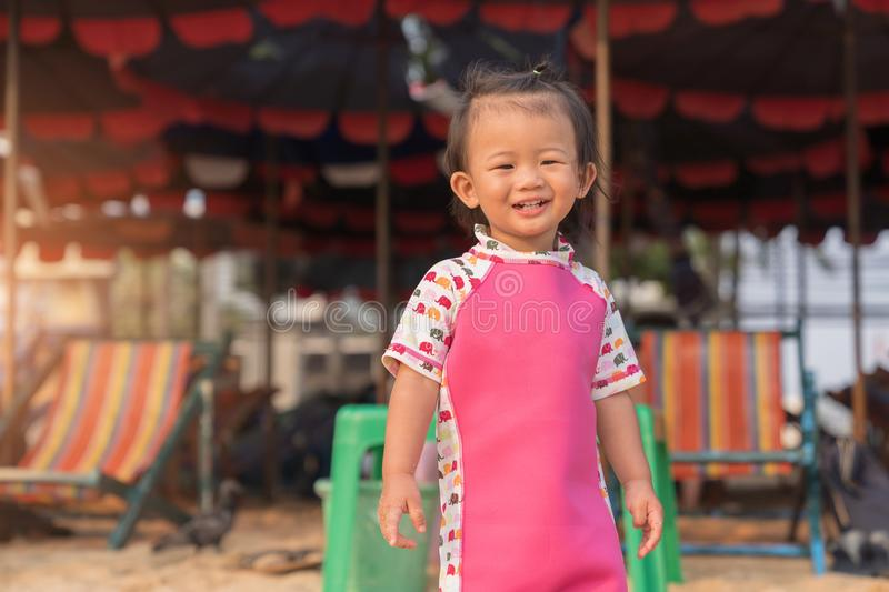 Asian cute baby girl smiling on the beach background. royalty free stock images