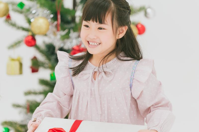 Asian cute girl child happy smiling with her big gift stock photos