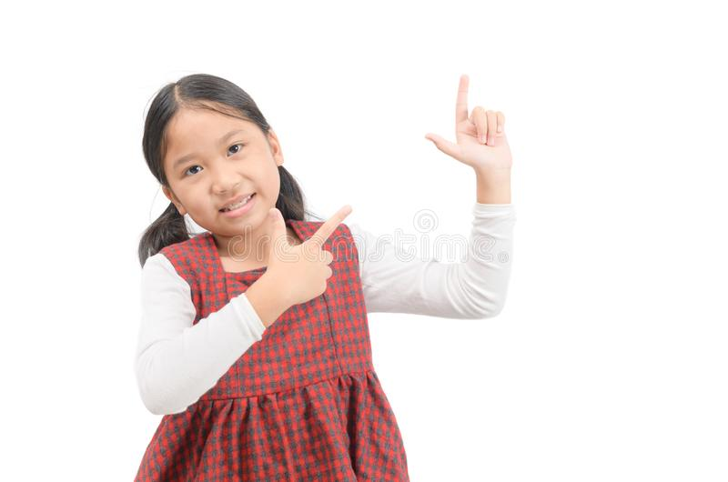 Asian cute girl pointing at empty space isolated on white stock image