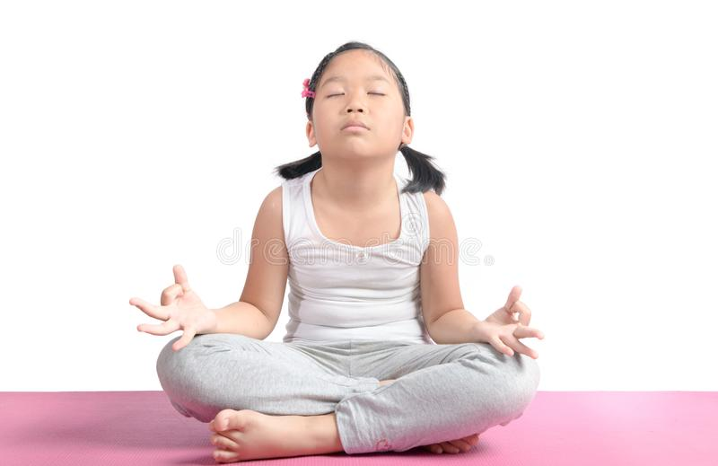 Asian cute girl sitting on floor meditating. royalty free stock images