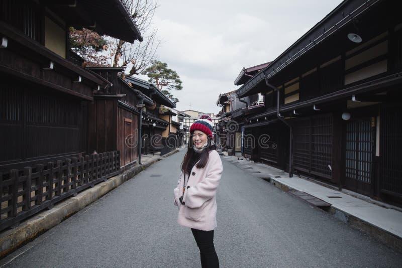 Tourist Girl in old town Takayama, Japan royalty free stock images