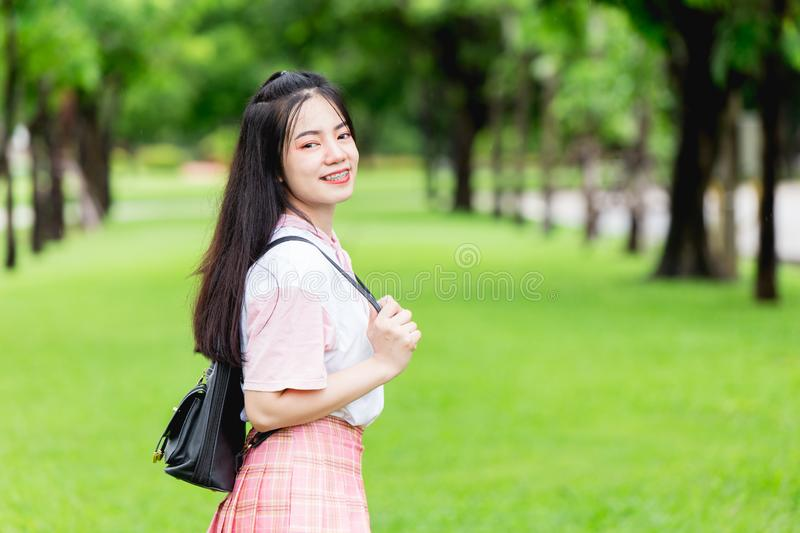 Asian cute girl teen smiling with braces teeth outdoor green royalty free stock photos