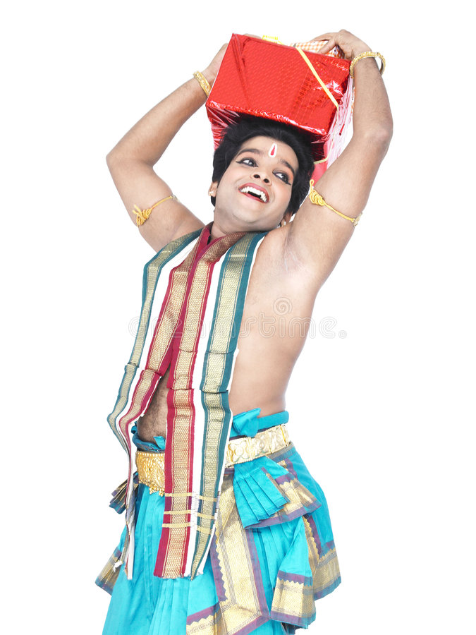 Asian dancer with a gift box. South India with a gift box on his head royalty free stock photography