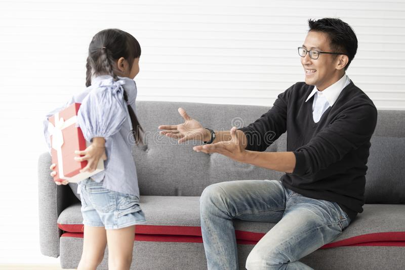 Asian daughter give present for father. concept surprise gift box for birthday.  royalty free stock photos