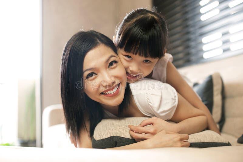 Asian daughter hugs mother stock photo