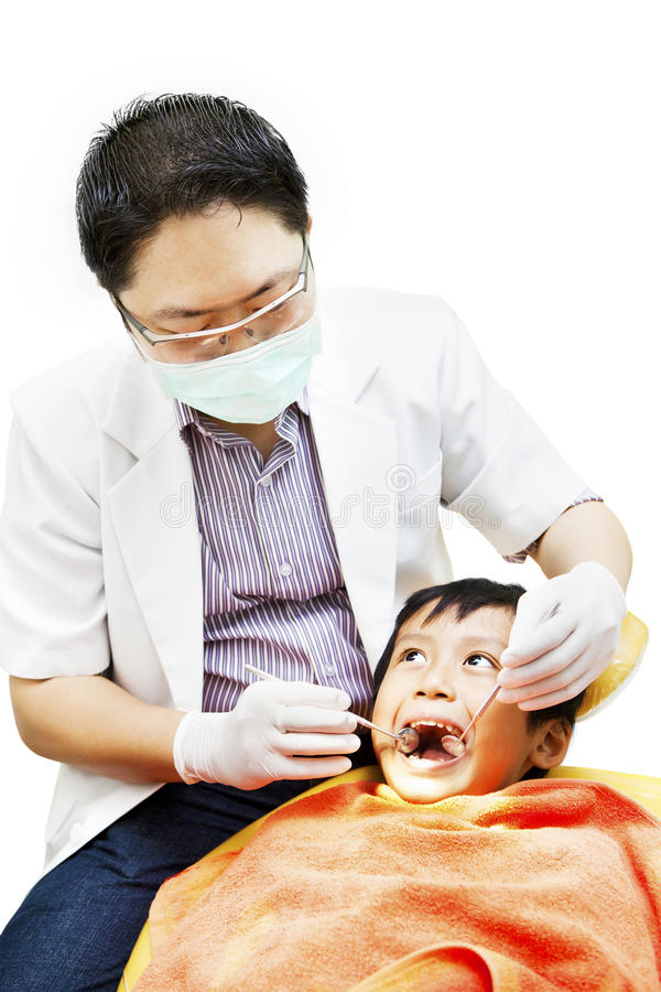 Asian Dentist And His Little Patient Royalty Free Stock Photo