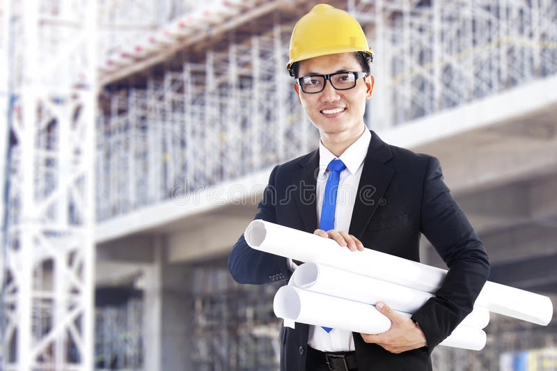 Asian developer with blueprints stock photography