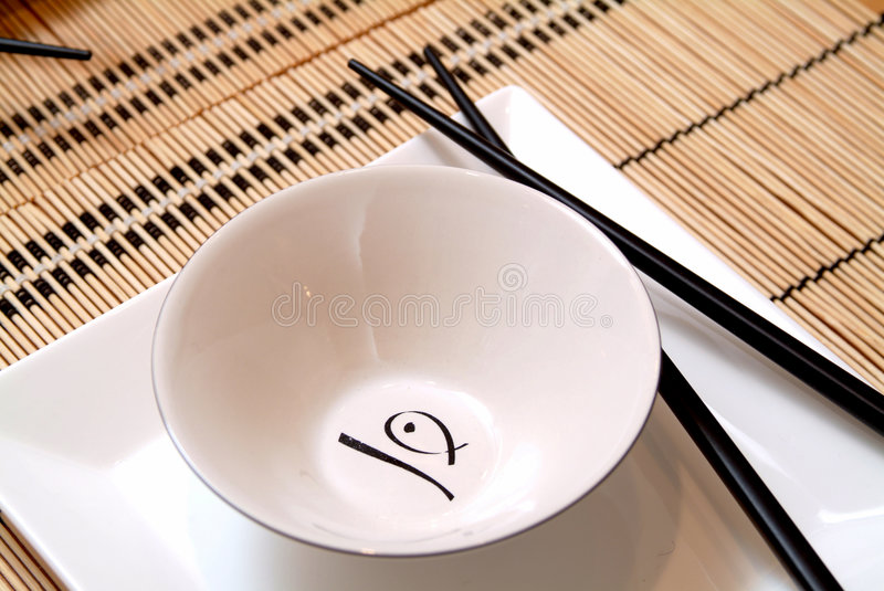 Asian dish. Asian specialty dish over table with chopsticks stock photos