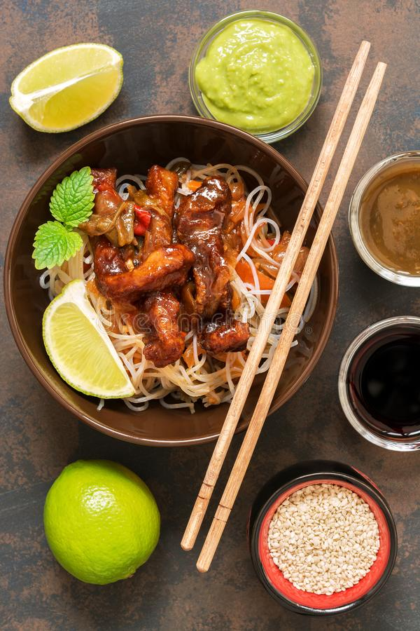 Asian dish glass noodles with vegetables and meat. Pork fried with sweet sour sauce. Stir-Fred royalty free stock photography