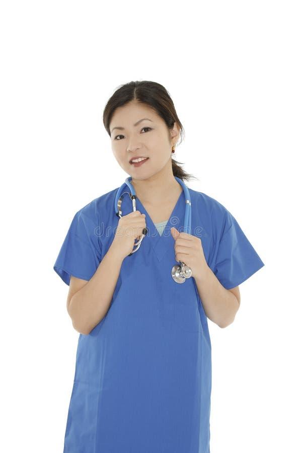 Beautiful Asian woman doctor or nurse wearing scrubs. Portrait of a beautiful Asian woman doctor or nurse wearing scrubs isolated on a white background stock photos