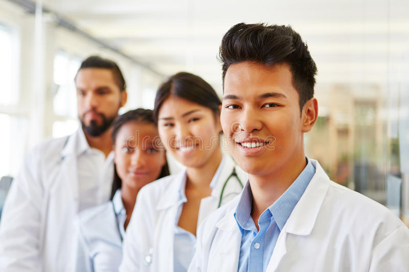 Asian doctor assistant with team stock images
