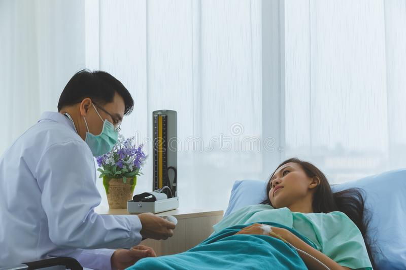 Asian doctor check the sickness of female patient..Asian doctor check the sickness of female patient..Asian doctor check the stock images