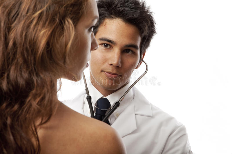 Asian doctor listening to the heartbeat stock image