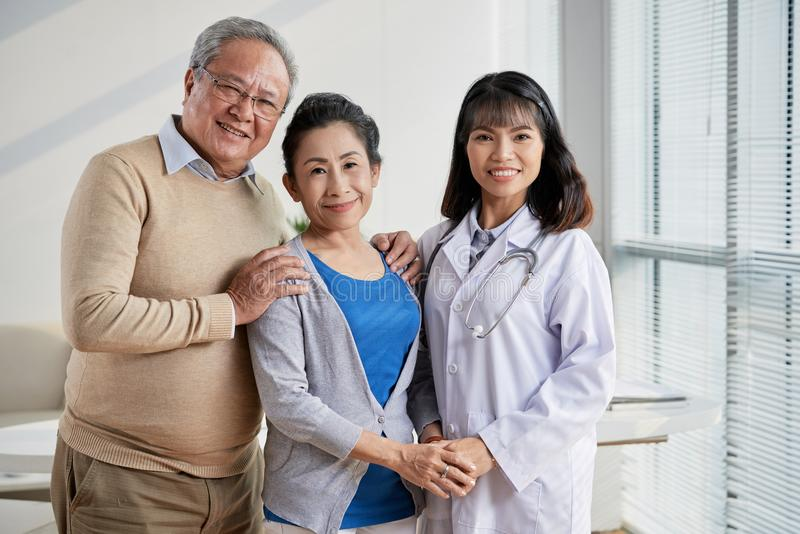 Asian Doctor with Senior Patients stock images