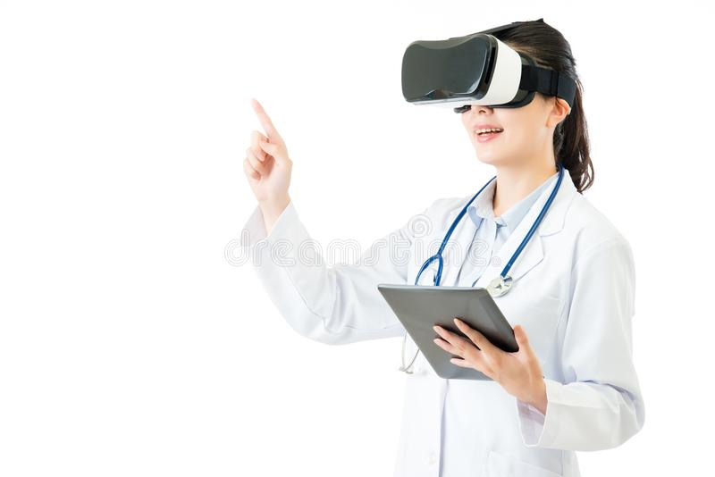 Asian doctor use digital tablet press VR headset screen royalty free stock photo