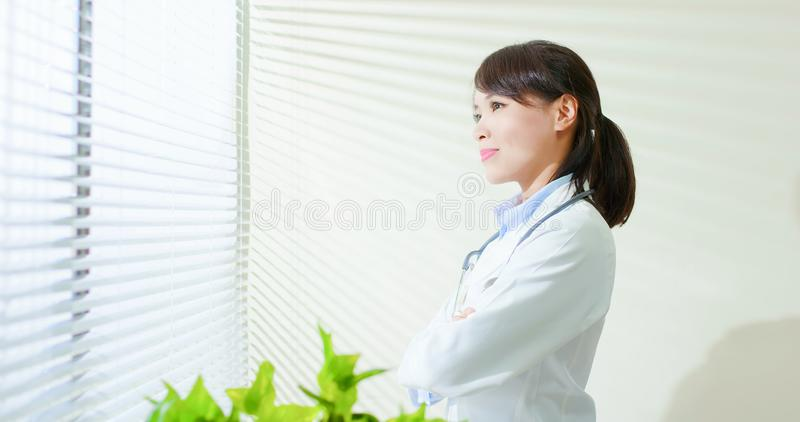 Asian doctor woman look outside stock images
