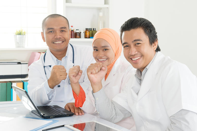 Asian doctors celebrating success stock photo