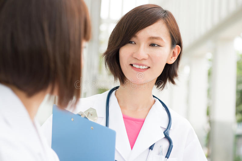 Asian doctors having discussion royalty free stock image
