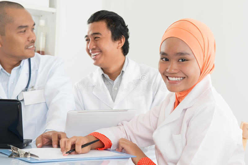 Asian doctors meeting at hospital office. royalty free stock photo