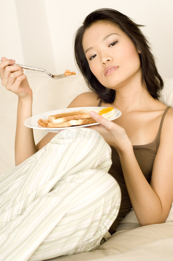Download Asian Eating Breakfast Royalty Free Stock Images - Image: 1289369