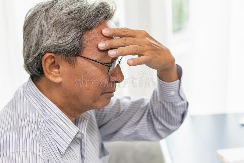 Asian elder headache pain suffer from stress royalty free stock image