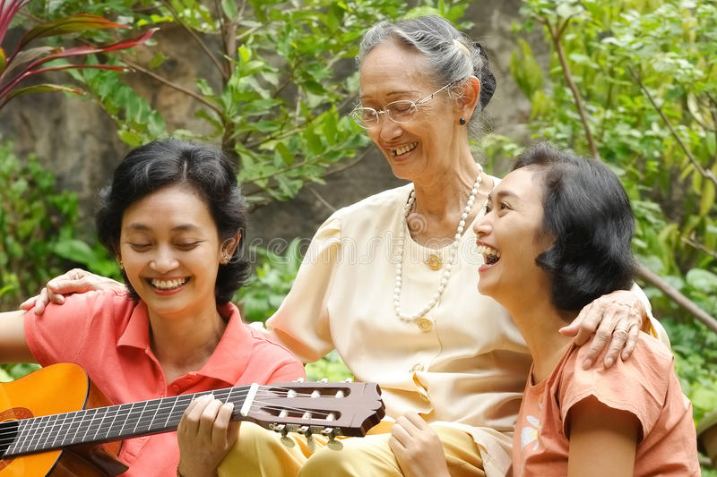 Asian elderly mother and daughter fun together stock photography